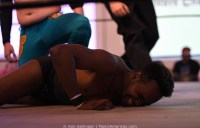 A wrestler lands on the mat face-first