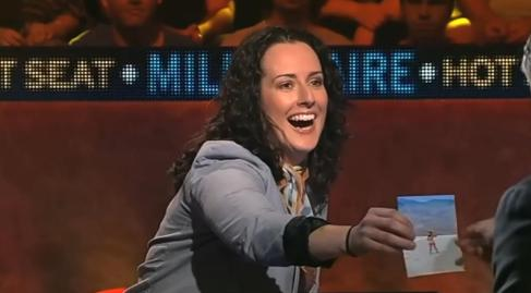 Nat showing Eddie her bum on Millionaire HotSeat Screen grab- Ch 9