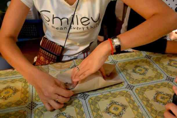 Rice wrapping for poor kids- #volunteerinasia #volunteerincambodia maninio.com