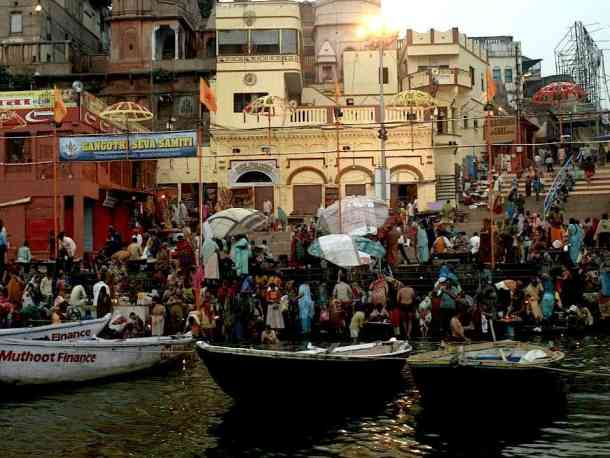 Varanasi (India): Between life & death, early morning prayers. Best Things to Do. maninio.com