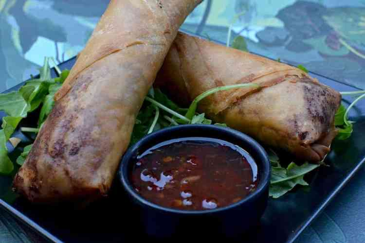 Spring rolls with sauce at Roots, Thessaloniki. maninio.com #veganfoodingreece #greekvegan