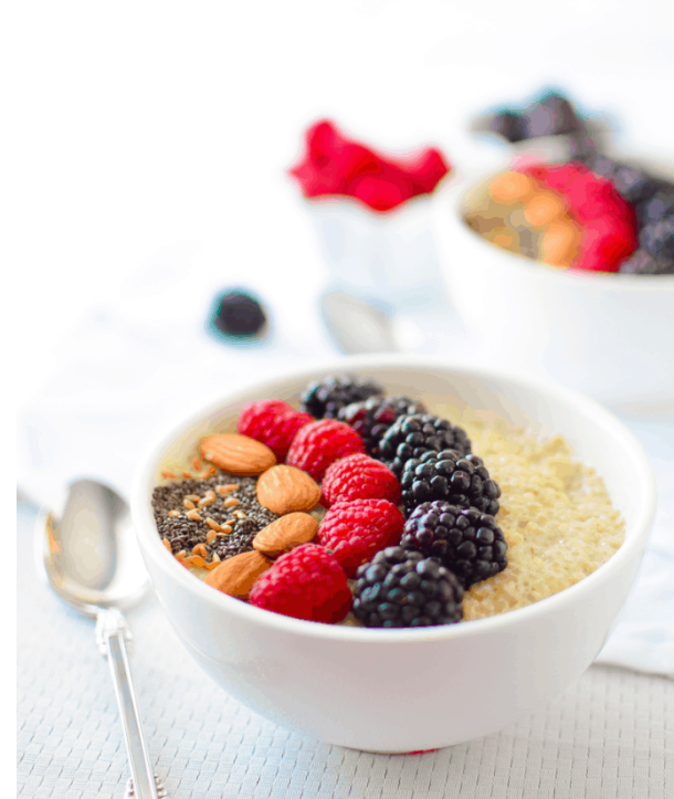 Emilykylenutrition - Berry Quinoa Breakfast Bowl - Vegan Healthy Breakfast Ideas to Start your day. maninio.com