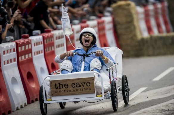Competitors perform during the Red Bull Soap Box Race in Sha Tin, Hong Kong on October 14, 2012