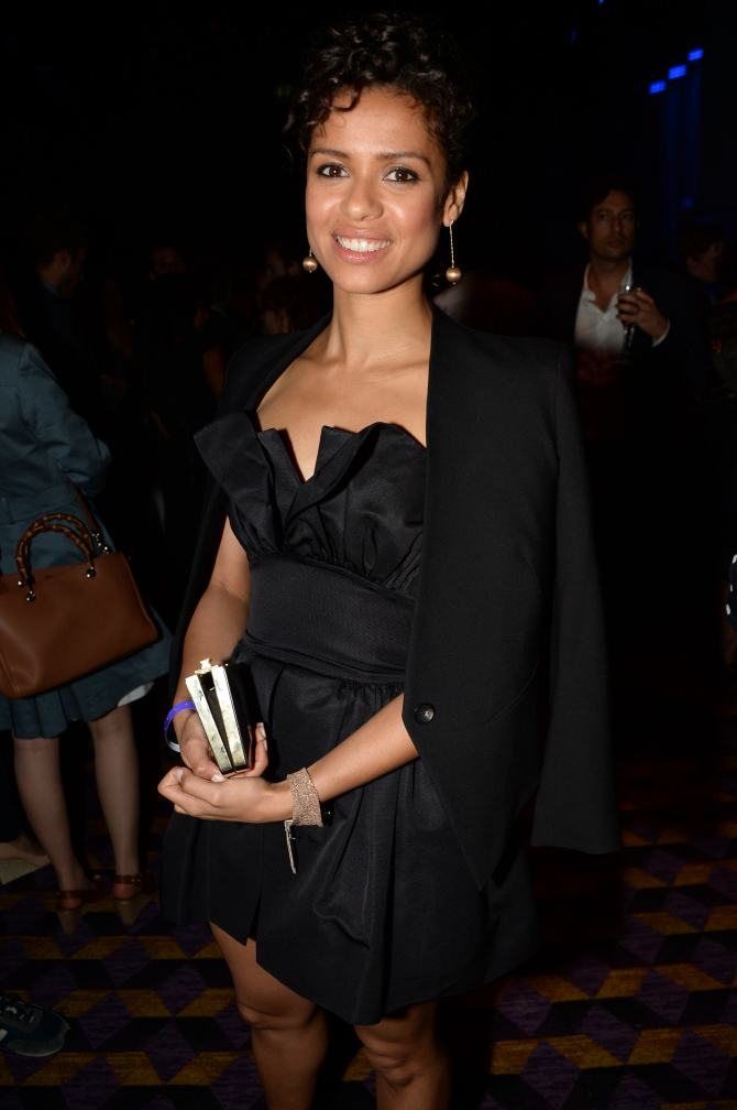 Gugu Mbatha-Raw wears a Martin Grant playsuit with Christian Louboutin heels.