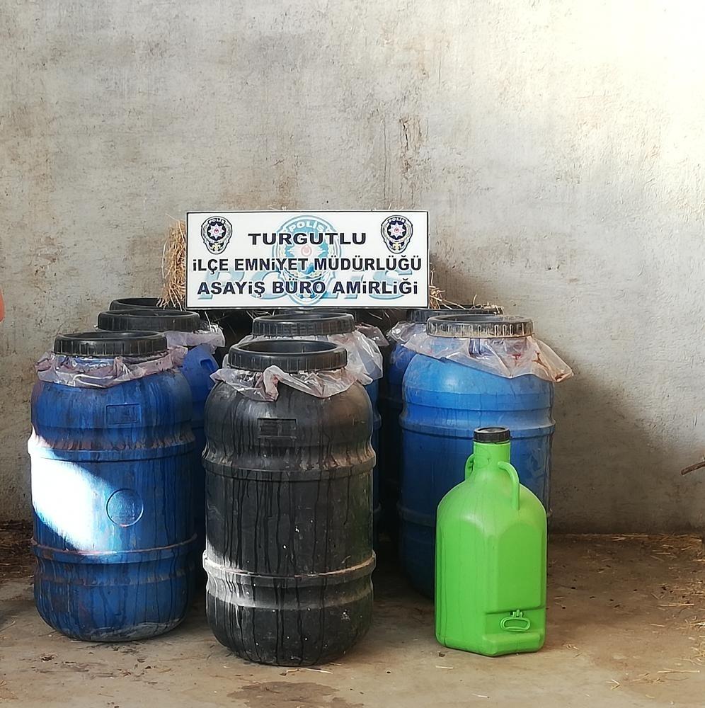 Samanların arasına gizlenmiş 2 ton sahte içki ele geçirildi
