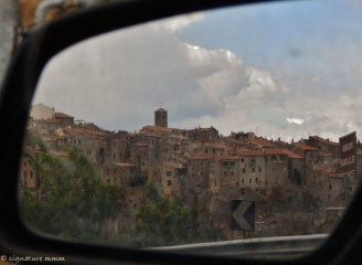 Pitigliano in the rearview mirror.
