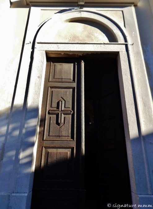The door of St. Martin Church in Šmartno. From the outside...