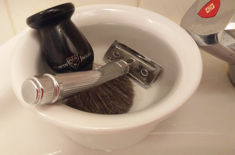 How to use a shaving brush properly. Soak the brush in warm water to prepare the natural hair