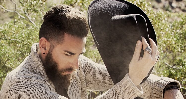 Brushed up short hairstyle for men with beard