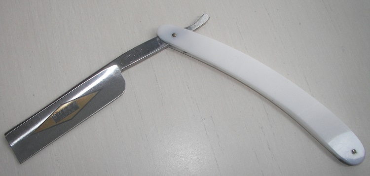 Square edge straight razor