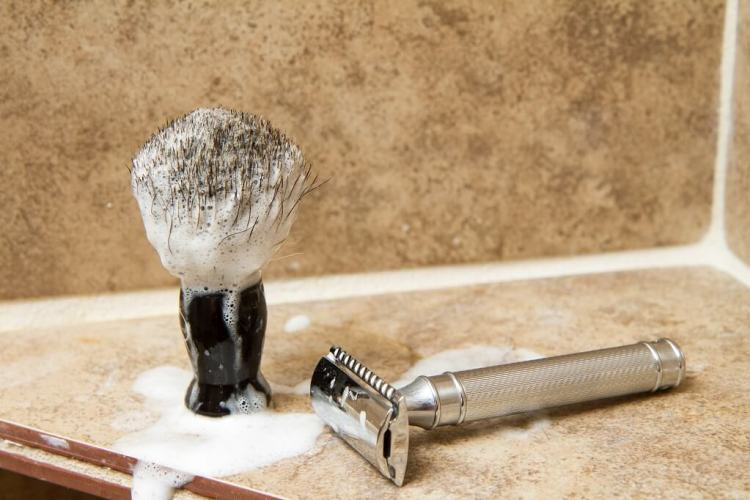 Use a safety razor and shaving brush for smooth skin preventing skin irritation