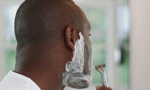 Nigerian man shaving