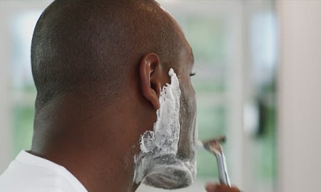 Nigerian man shaving