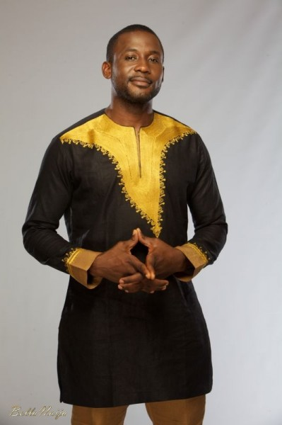 actor in black yoruba men native wear with gold embroidery