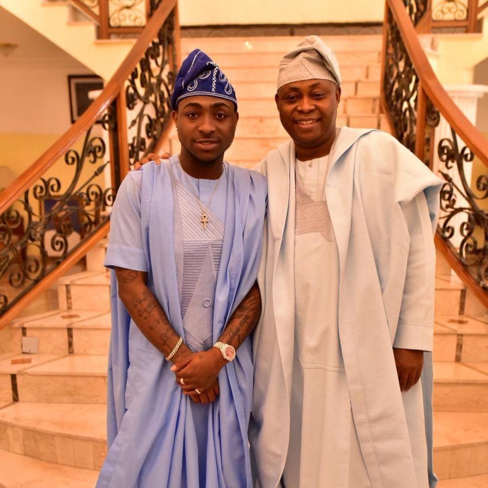 Davido and his father in traditional yoruba agbada wear