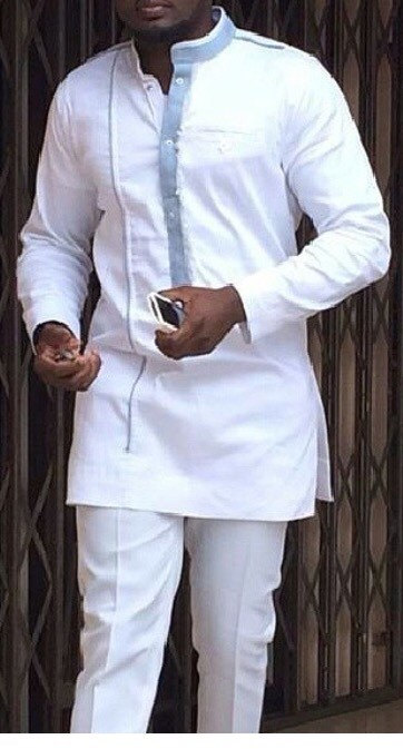 White guinea worn by black man