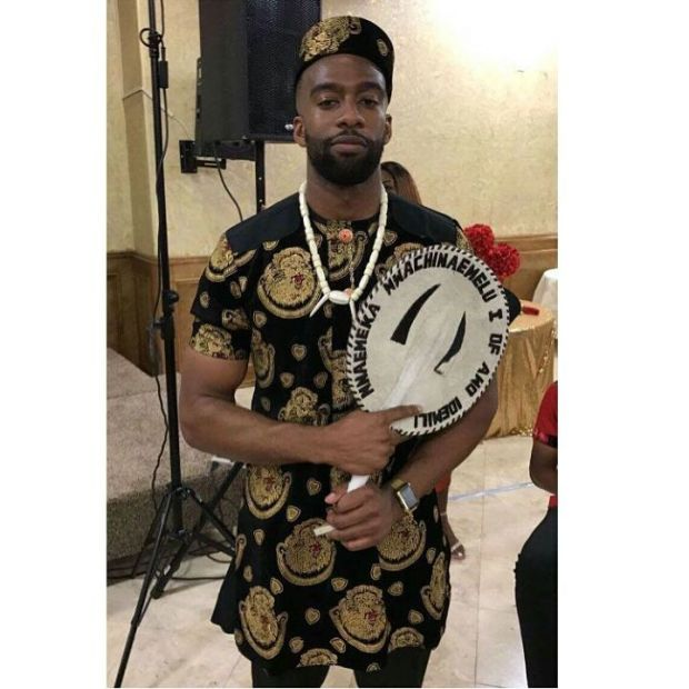 igbo men with traditional fan