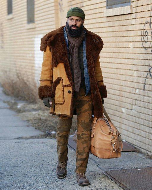 man with brown bag