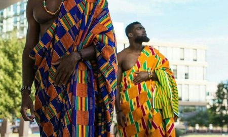 2 ghanian men in Kente Fabric
