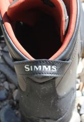 This photo shows the rear heel grab loop on the Simms Freestone Boot.