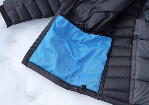 This KÜHL Firestorm Down Jacket review photo shows the interior blue goggle pocket.