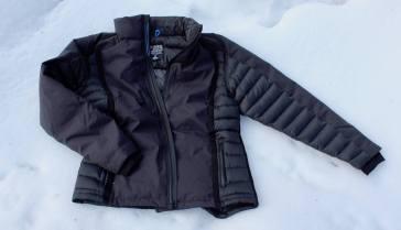 This KÜHL Firestorm Down Jacket review photo shows the front of the Firestorm Down Jacket on snow.