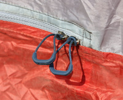 This photo shows the ultralight zipper pulls on the REI Quarter Dome 2 Tent.