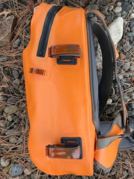 This photo shows the side view of the Fishpond Thunderhead Submersible Backpack.
