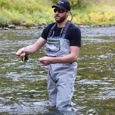 This photo shows a fisherman wearing the Orvis Ultralight Convertible Waders and Orvis Ultralight Wading Boots.