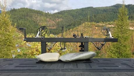 This photo shows the LCA PACK-N-GO portable bow press outside in a forest.