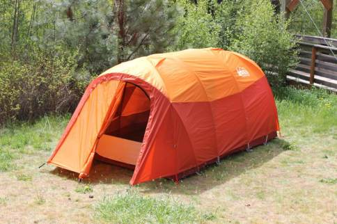 This photo shows the REI Co-op Kingdom 8 Tent setup with rainfly and vestibule open.