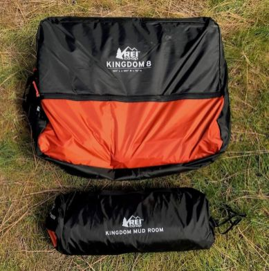 This photo shows the REI Co-op Kingdom 8 Tent bag next to the Mud Room accessory bag.