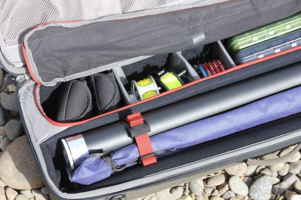 This photo shows a closeup of the Simms Bounty Hunter Vault rod and reel case interior.