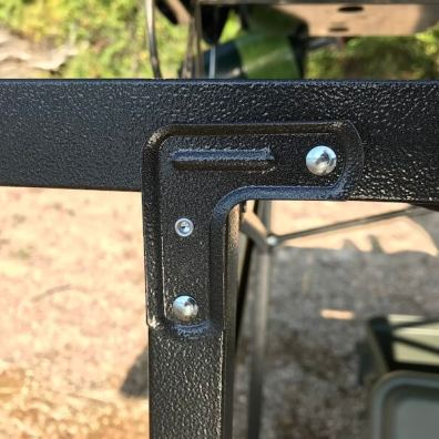 This photo shows the angle bracket on the Mountain Summit Gear Heavy-Duty Roll-Top X-Large Camping Table.