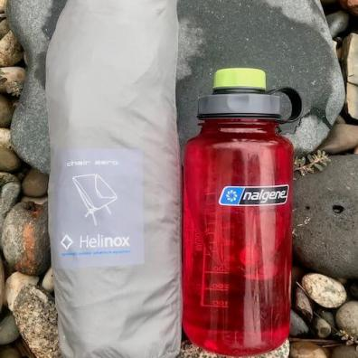 This photo shows the Helinox Chair Zero packed next to a Nalgene water bottle as a size reference.