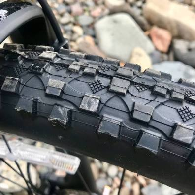 This review photo shows the tires on the REI Co-op Cycles DRT 1.2.