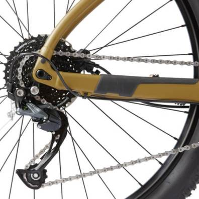 This photo shows a closeup of the rear derailleur on The REI Co-op Cycles DRT 1.2 mountain bike.