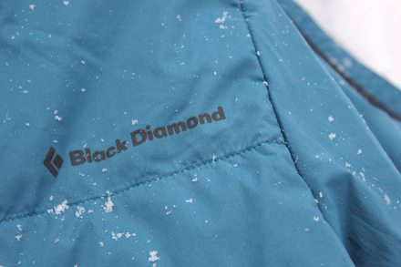 This photo of the Black Diamond First Light Stretch Hoody shows a closeup of the logo and stitching.