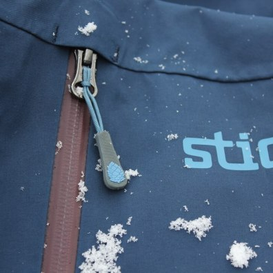 This photo shows a closeup of the top left pocket and logo on the Stio Environ Jacket.