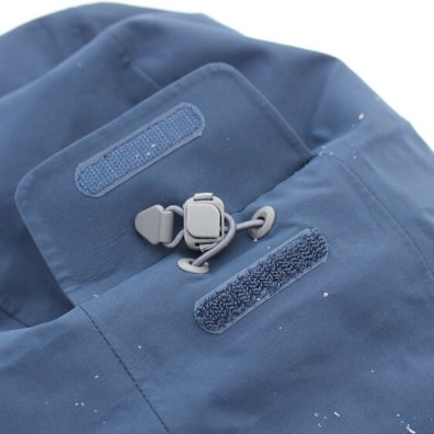 This photo shows the adjustment cords for the hood on the Stio Environ Jacket.