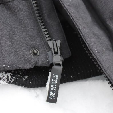 This photo shows the Triple F.A.T. Goose Norden Hooded Bomber Jacket zipper.