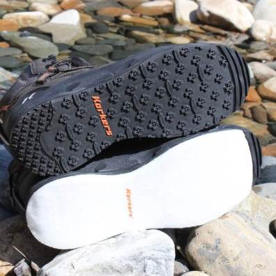 This photo shows two OmniTrax Interchangeable Soles on the Korkers Terror Ridge wading boots.