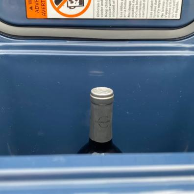This photo shows the YETI Roadie 24 with a bottle of wine inside.