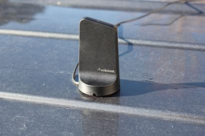 This photo shows the external antenna of the weBoost Drive Reach when it's installed on a pickup truck.