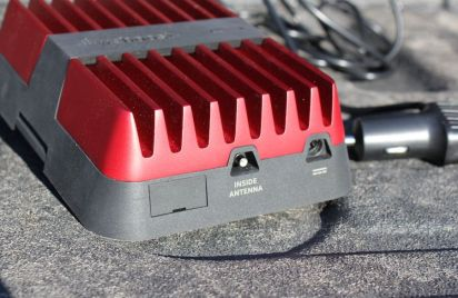 This photo shows the inside antenna and power ports on the weBoost Drive Reach.