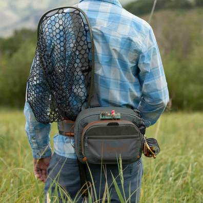 This photo illustrates how the Fishpond Switchback Pro Wading Belt System with a fly fishing net accessory works while being worn by an angler.