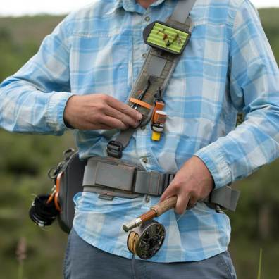 This photo shows how the shoulder strap on the Fishpond Switchback Pro Wading Belt System with fly fishing accessories works while fly fishing.