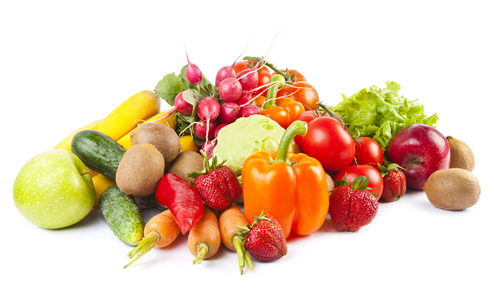 Composition of fruits and vegetables on white background