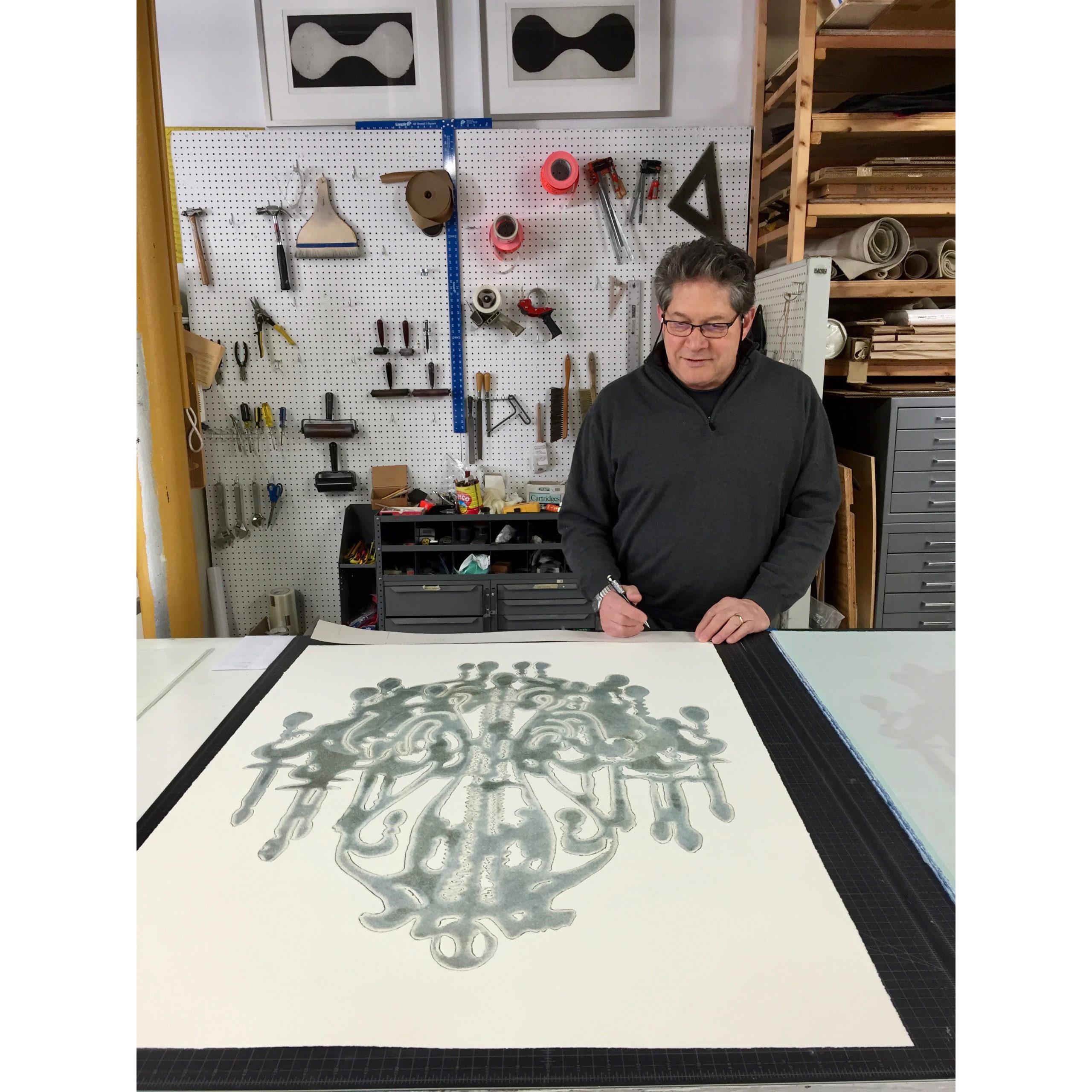 Gary Justis signing his chandelier monoprints at Manneken Press, 2016