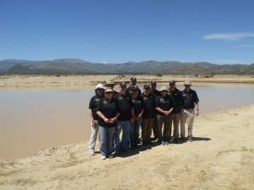 Travelers from Rotary International visiting the Jusku Molle water reservoir project in April, which Mano a Mano completed with their support.